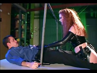 Redhead bonking concerning gloves together with a latex uniform