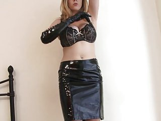Deviant blonde less latex masturbates wearing gloves