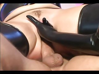 One girls nigh latex skivvies with an increment of gloves fucking