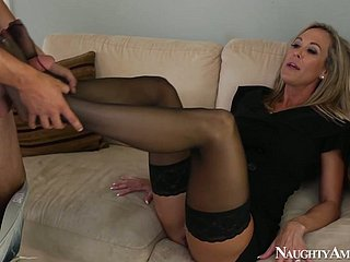 Crooked housewife beside pantyhose Brandi Love provides a ladies' with a footjob